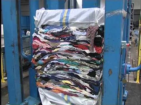 Pit press for baling used clothing - YouTube