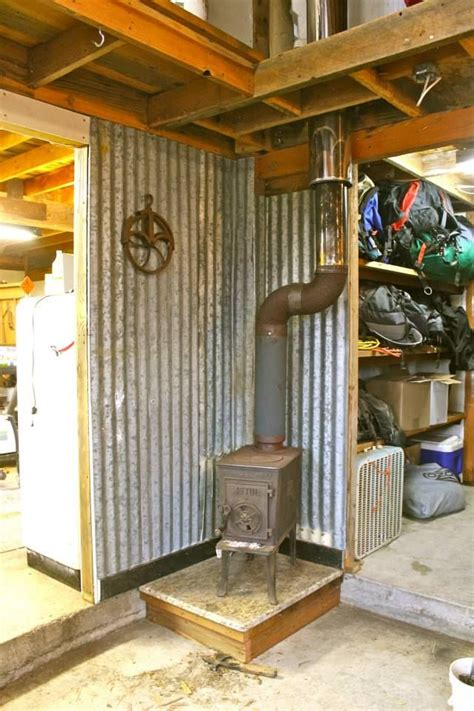 Old wood stove with galvanized roof wall protection